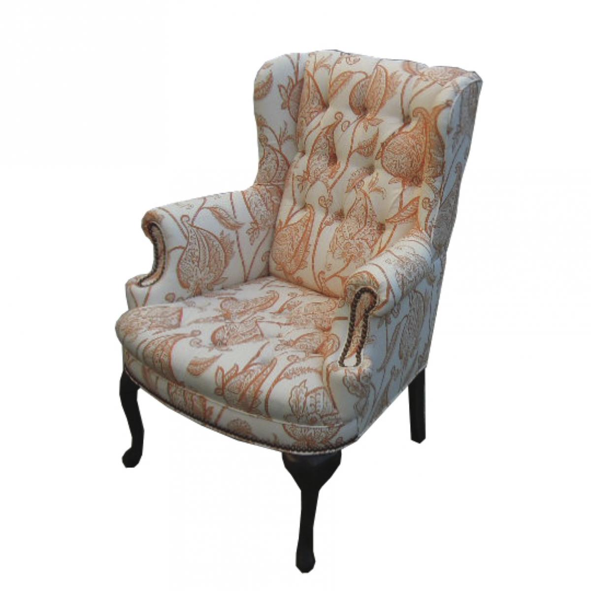 Reupholstered wing chair with tufting in white and orange fabric
